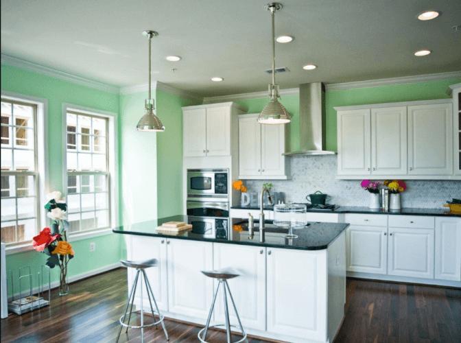 green kitchen cream cabinets