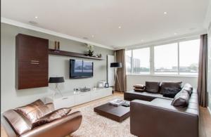 brown living room tv on wall shelf for media