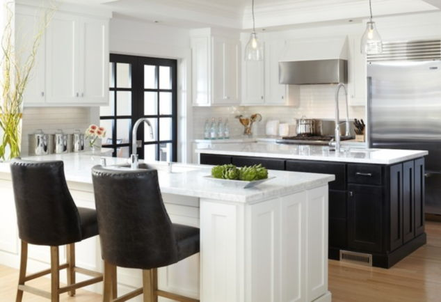 kitchens with black appliances and white cabinets