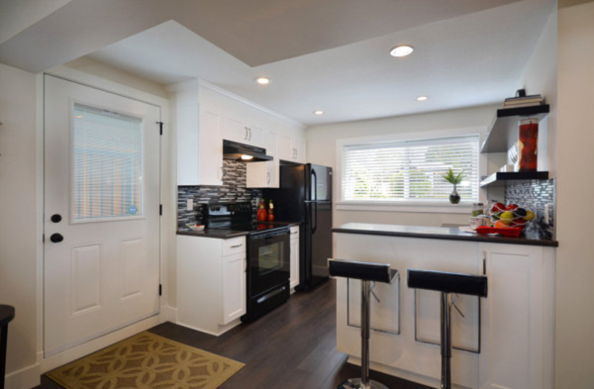 kitchens with black appliances and wood floors