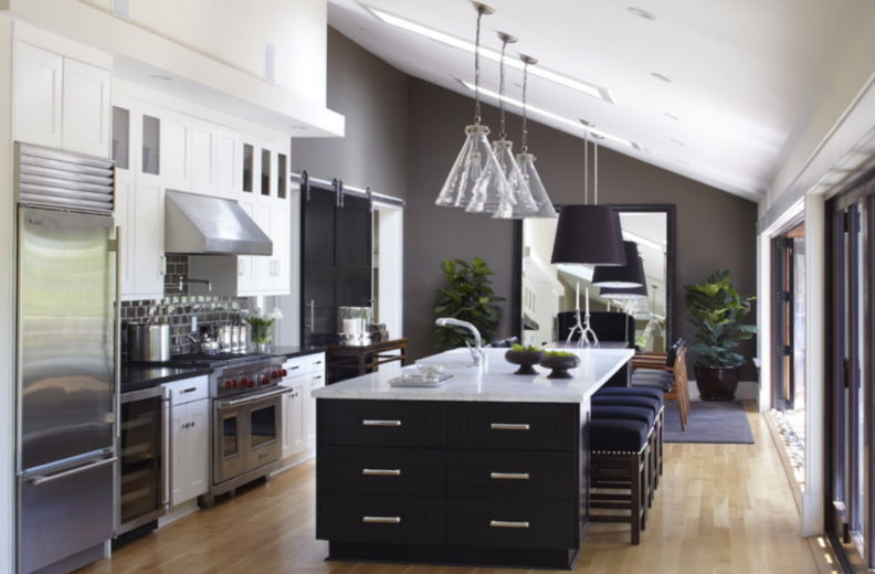 kitchens with wood cabinets and black appliances