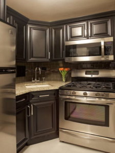 small kitchens with black appliances